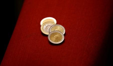 Argentine coins of 1 and 2 pesos are pictured in Buenos Aires