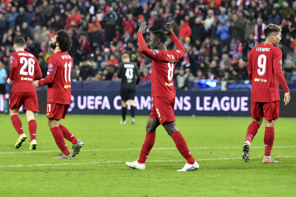 Liverpool's Naby Keita, center, celebrates after scoring his side's opening goal during the group E Champions League soccer match between Salzburg and Liverpool, in Salzburg, Austria, Tuesday, Dec. 10, 2019. (AP Photo/Kerstin Joensson)