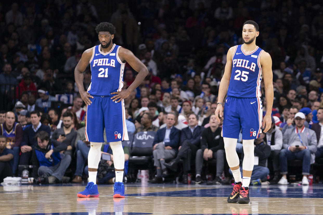 PHILADELPHIA, PA - DECEMBER 02: Joel Embiid #21 and Ben Simmons #25 of the Philadelphia 76ers look on against the Utah Jazz at the Wells Fargo Center on December 2, 2019 in Philadelphia, Pennsylvania. NOTE TO USER: User expressly acknowledges and agrees that, by downloading and/or using this photograph, user is consenting to the terms and conditions of the Getty Images License Agreement. (Photo by Mitchell Leff/Getty Images)