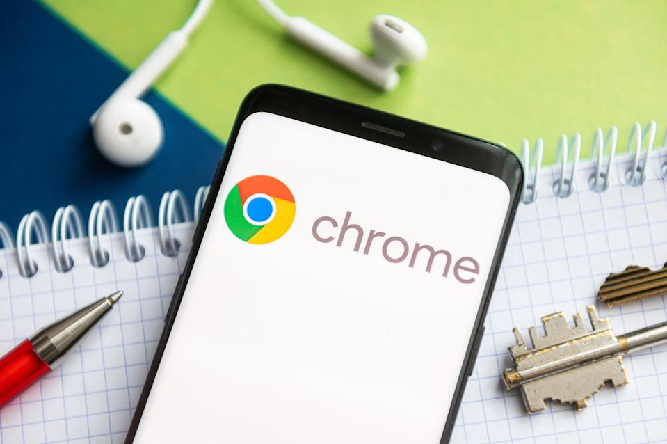 POLAND - 2021/02/09: In this photo illustration, a Google Chrome logo seen displayed on a smartphone with a pen, key, book and headsets in the background. (Photo Illustration by Mateusz Slodkowski/SOPA Images/LightRocket via Getty Images)