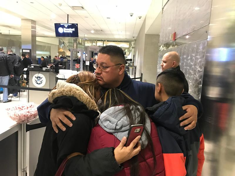 Jorge Garcia, 39, of Lincoln Park, Michigan, hugs his wife, Cindy Garcia, and their two children Jan. 15, 2018, at Detroit Metro Airport moments before being forced to board a flight to Mexico to be deported. (Niraj Warikoo/Detroit Free Press/USA Today Sports Images)