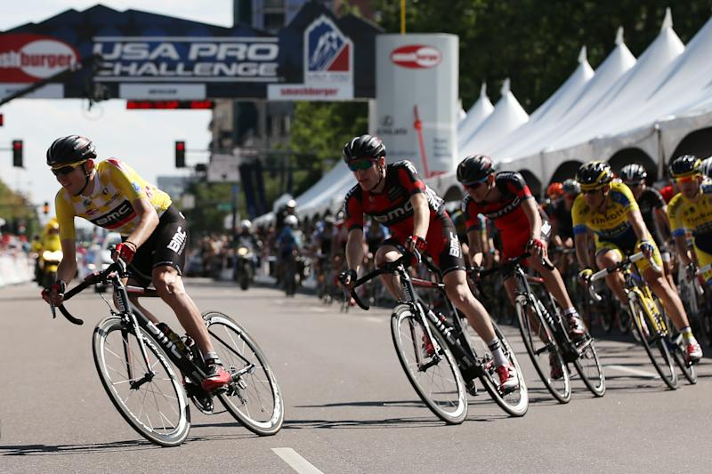 Tejay van Garderen (L) rides in the peloton during the final stage of the USA Pro Challenge cycling race on August 24, 2014 in Denver, Colorado