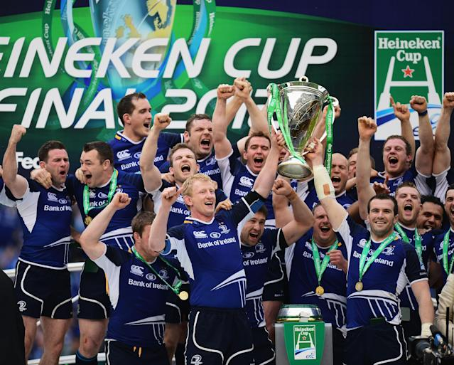 LONDON, ENGLAND - MAY 19: Leo Cullen (L) and Shane Jennings (R) lift the trophy in celebration with Leinster team mates following their victory during the Heineken Cup Final between Leinster and Ulster at Twickenham Stadium on May 19, 2012 in London, United Kingdom. (Photo by Jamie McDonald/Getty Images)