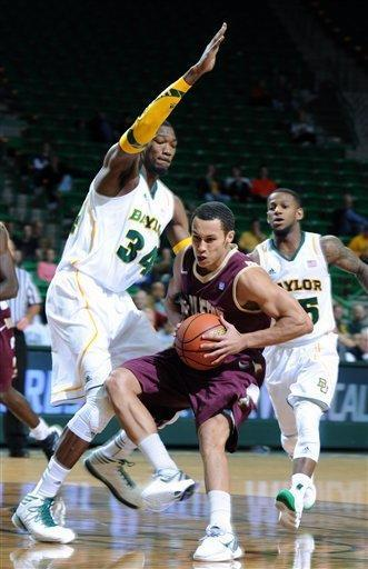 College of Charleston's Andrew Lawrence (4), right, is guarded by Baylor's Cory Jefferson (34), left, in the first half of an NCAA college basketball game on Saturday Nov. 24, 2012, in Waco, Texas. (AP Photo/Waco Tribune Herald, Rod Aydelotte)