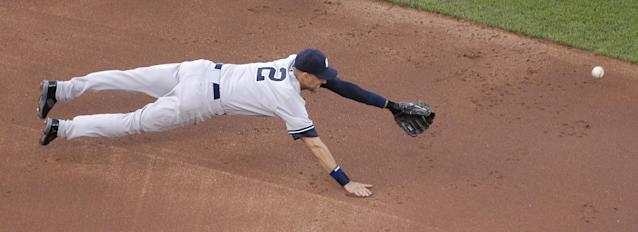 New York Yankees shortstop Derek Jeter dives for but misses an RBI single hit by Kansas City Royals' Alcides Escobar during the second inning of a baseball game Saturday, June 7, 2014, in Kansas City, Mo. (AP Photo/Charlie Riedel)