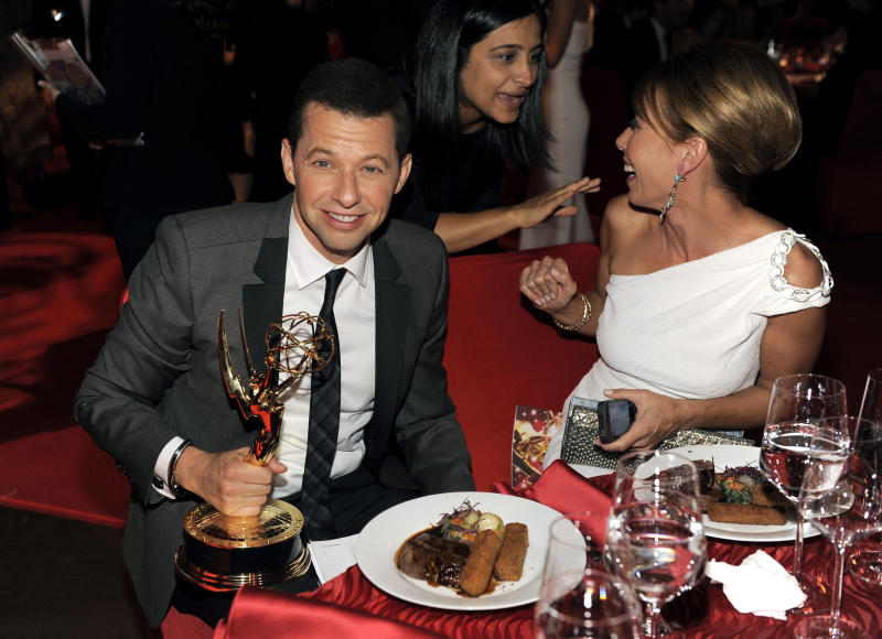 "Jon Cryer, with his award for outstanding leading actor in a comedy series for ""Two and a Half Men"", left, and wife LIsa Joyner are seen at the 64th Primetime Emmy Awards Governors Ball on Sunday, Sept. 23, 2012, in Los Angeles. (Photo by Chris Pizzello/Invision/AP)"