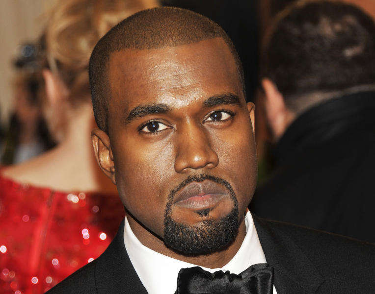 FILE - In a Monday, May 7, 2012 file photo, Kanye West arrives at the Metropolitan Museum of Art Costume Institute gala benefit, in New York. West announced that his girlfriend Kim Kardashian is pregnant at a concert in Atlantic City Sunday night, Dec. 30, 2012. (AP Photo/Charles Sykes, File)