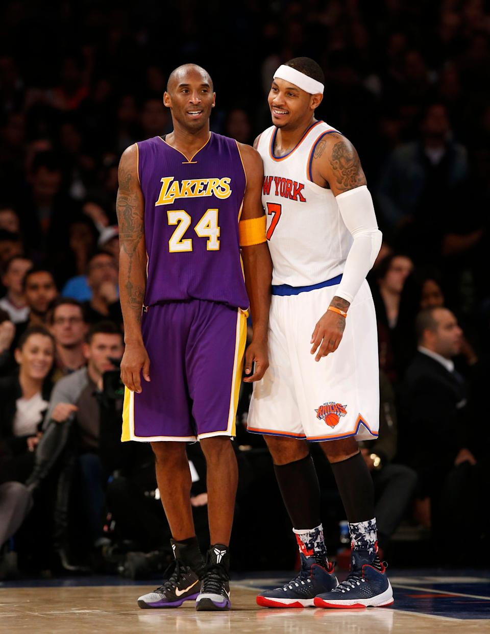 Los Angeles Lakers forward Kobe Bryant (24) chats with New York Knicks forward Carmelo Anthony (7) during a lull in play in the second half of an NBA basketball game at Madison Square Garden in New York, Sunday, Nov. 8, 2015.