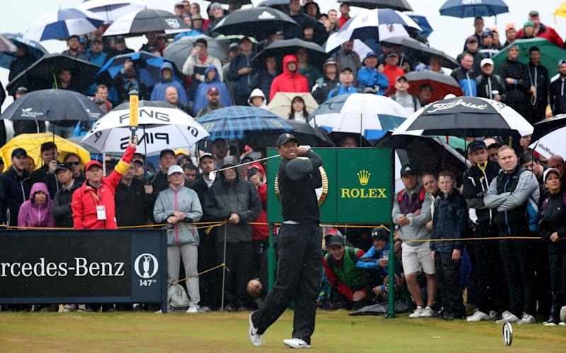 The rain did not deter the hoards of fans that followed Tiger Woods throughout his second round - PA