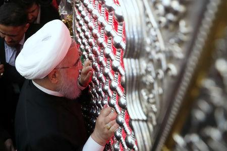 Iranian President Hassan Rouhani visits the Imam Ali shrine in Najaf, Iraq March 13, 2019. Official Iranian President website/Handout via REUTERS