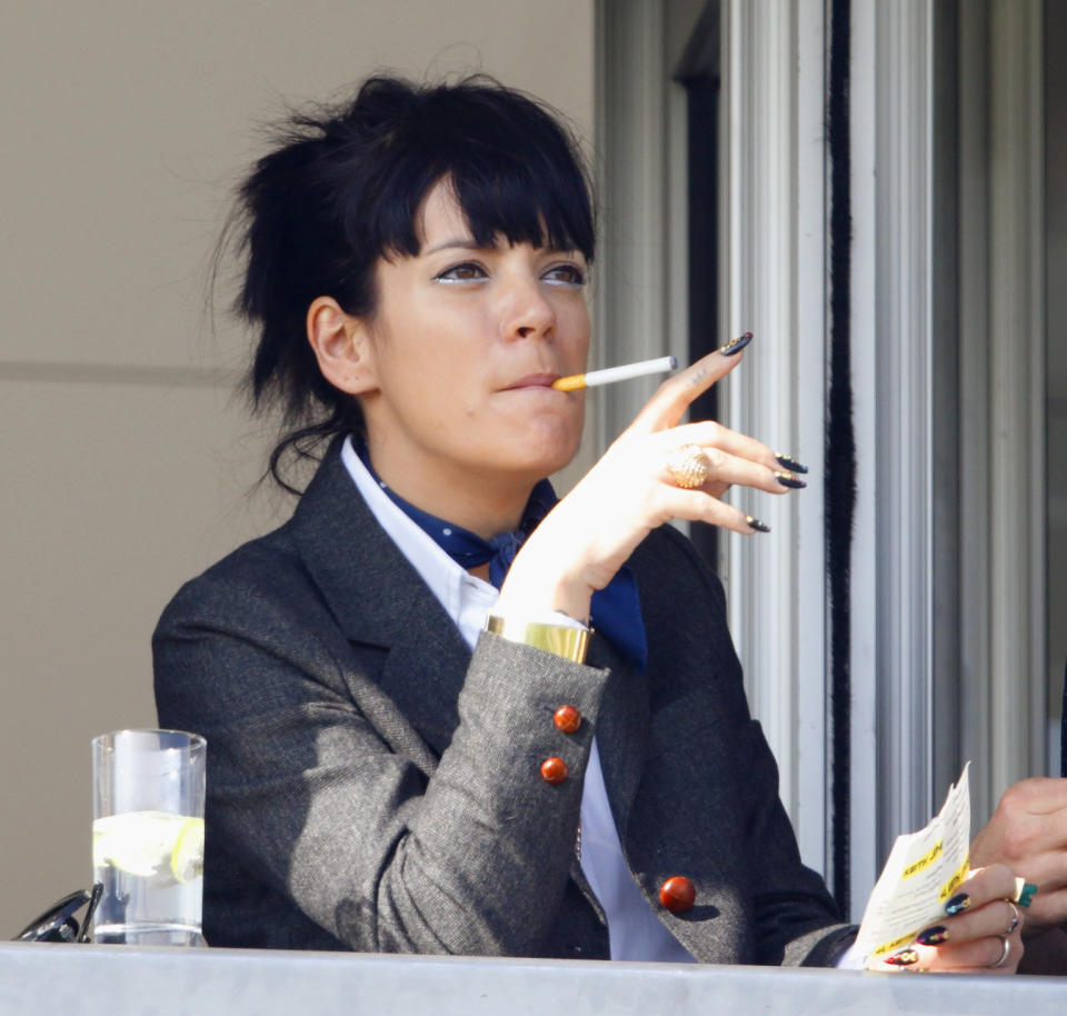 CHELTENHAM, UNITED KINGDOM - MARCH 14: (EMBARGOED FOR PUBLICATION IN UK NEWSPAPERS UNTIL 48 HOURS AFTER CREATE DATE AND TIME) Lily Allen watches the racing as she attends Day 4 of the Cheltenham Festival at Cheltenham Racecourse on March 14, 2014 in Cheltenham, England. (Photo by Max Mumby/Indigo/Getty Images)