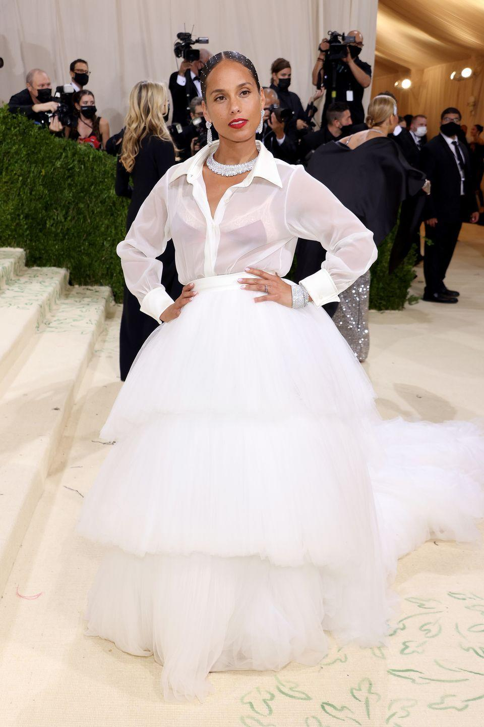<p>Keys dressed up a sheer shirt with a tulle skirt.</p>