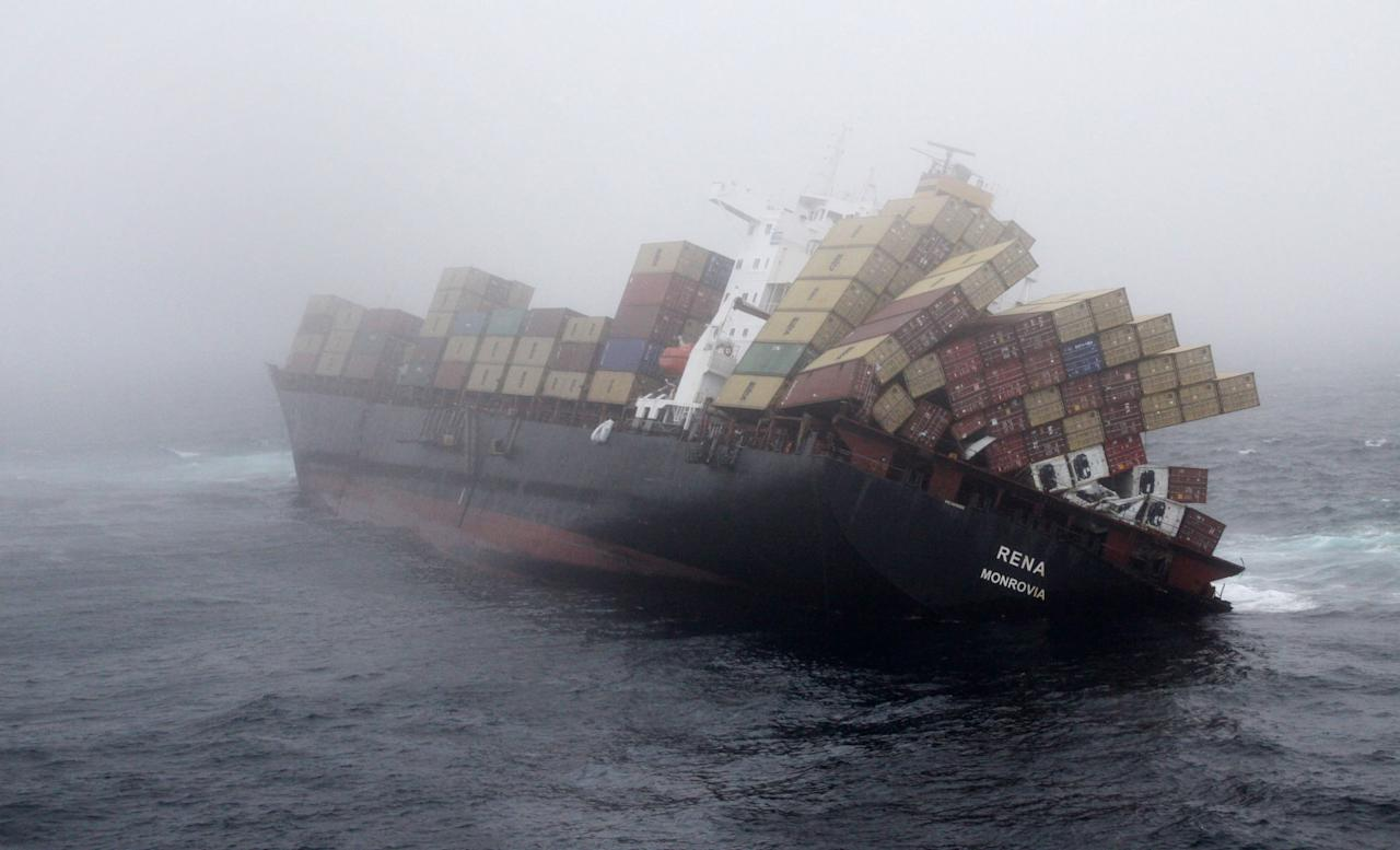 In this handout provided by Maritime New Zealand, MV Rena is battered by strong seas as it is stuck on Astrolabe Reef, on November 2, 2011 in Tauranga, New Zealand. The stricken vessel encountered a three metre swell, which led authorities to fear it may finally break up. Rena struck the reef on October 5, and has spilled 350 tonnes of oil, and almost 100 shipping containers. (Photo by Graeme Brown/Maritime New Zealand via Getty Images)