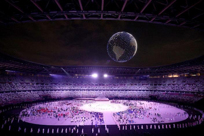 A drone display is seen over the top of the stadium during the Opening Ceremony of the Tokyo 2020 Olympic Games