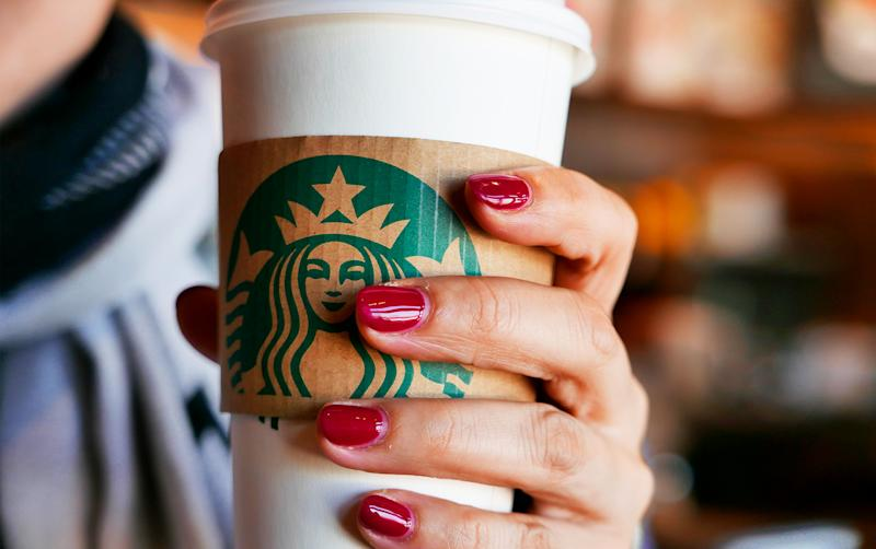 close up of person holding starbucks cup