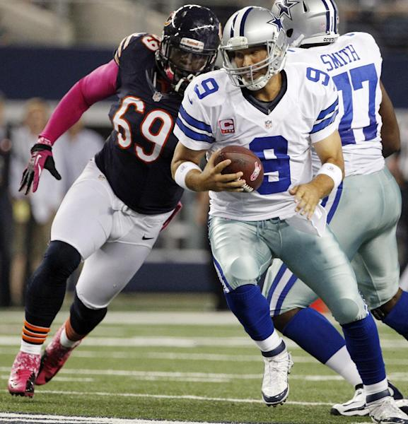 Chicago Bears defensive tackle Henry Melton (69) moves in to sack Dallas Cowboys quarterback Tony Romo (9) during the first half of an NFL football game, Monday, Oct. 1, 2012, in Arlington, Texas. (AP Photo/Tony Gutierrez)