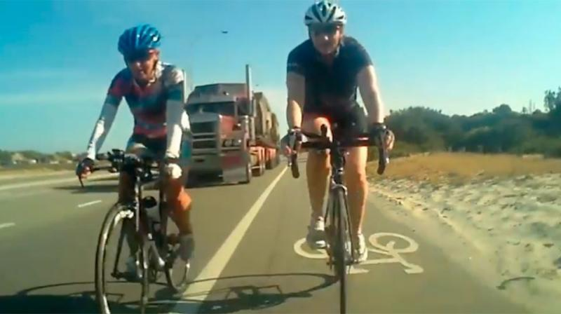 Footage shows the truck approaching as the unsuspecitng cyclists ride alongside each other. Source: Supplied