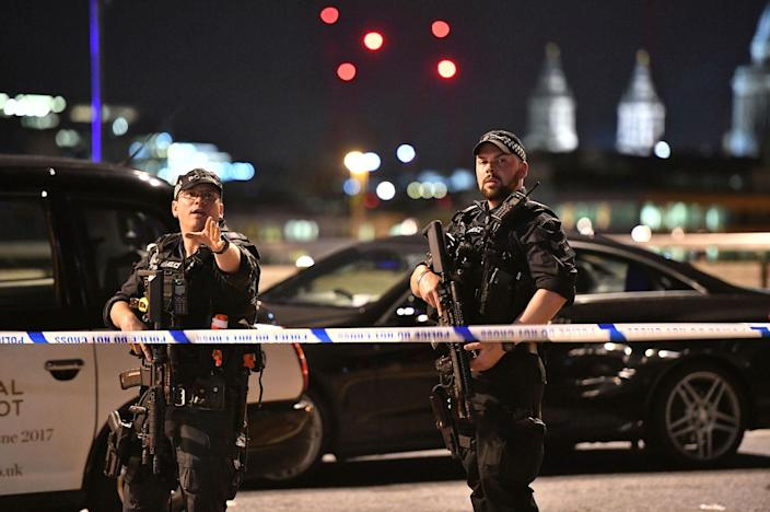 """<p>Armed Police officers stand guard on London Bridge in central London, Saturday, June 3, 2017. British police said they were dealing with """"incidents"""" on London Bridge and nearby Borough Market in the heart of the British capital Saturday, as witnesses reported a vehicle veering off the road and hitting several pedestrians. (Dominic Lipinski/PA via AP) </p>"""