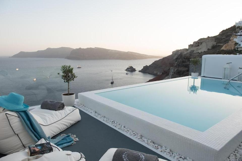 """<p>Set in the stunning village of Oia, <a href=""""https://go.redirectingat.com?id=127X1599956&url=https%3A%2F%2Fwww.booking.com%2Fhotel%2Fgr%2Fla-perla-villas.en-gb.html%3Faid%3D2070929%26label%3Dmini-moon&sref=https%3A%2F%2Fwww.redonline.co.uk%2Ftravel%2Fg37487695%2Fmini-moon%2F"""" rel=""""nofollow noopener"""" target=""""_blank"""" data-ylk=""""slk:La Perla Villas and Suites"""" class=""""link rapid-noclick-resp"""">La Perla Villas and Suites</a> provides a spectacular base for a picturesque mini-moon on the Greek island of Santorini. It's not just the sunsets that you'll be mesmerised here, as the adults-only retreat is the perfect place to hole away for a few nights, with its complex of cave houses and villas you can book for a romantic stay. Some feature hot tubs, while others come with their own infinity pools.</p><p><a class=""""link rapid-noclick-resp"""" href=""""https://go.redirectingat.com?id=127X1599956&url=https%3A%2F%2Fwww.booking.com%2Fhotel%2Fgr%2Fla-perla-villas.en-gb.html%3Faid%3D2070929%26label%3Dmini-moon&sref=https%3A%2F%2Fwww.redonline.co.uk%2Ftravel%2Fg37487695%2Fmini-moon%2F"""" rel=""""nofollow noopener"""" target=""""_blank"""" data-ylk=""""slk:CHECK AVAILABILITY"""">CHECK AVAILABILITY</a></p>"""