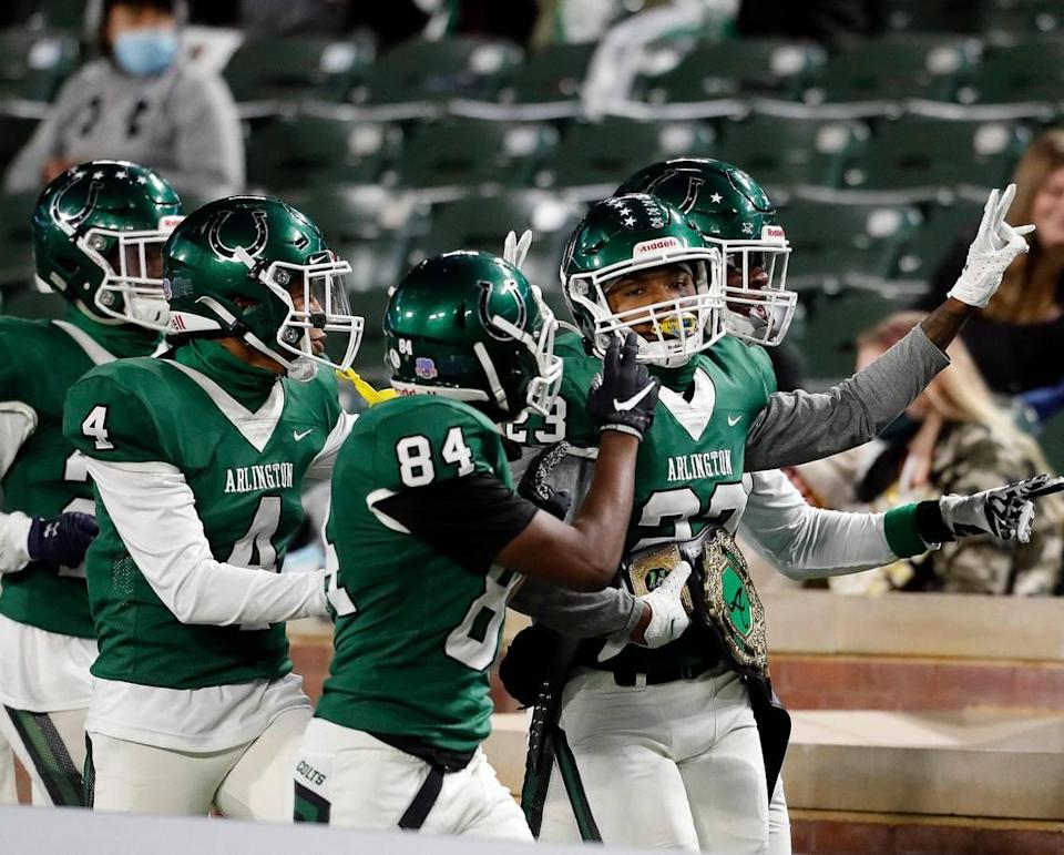 Arlington defensive back Richard Toney (23) parades around with the takeaway belt during a high school football game at Globe Life Park in Arlington Texas, Friday, Oct. 23, 2020. Toney had a pick six which also led to a 15 yard unsportsman like penalty for the Colts. The Colts defeated the Gophers 35-10. (Special to the Star-Telegram Bob Booth)