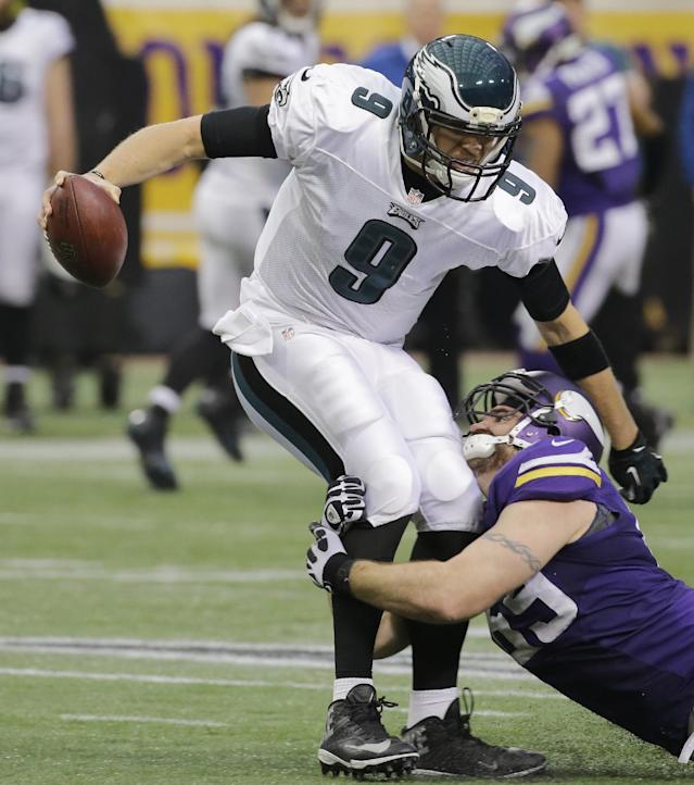 Philadelphia Eagles quarterback Nick Foles (9) is sacked by Minnesota Vikings defensive end Jared Allen during the second half of an NFL football game, Sunday, Dec. 15, 2013, in Minneapolis. (AP Photo/Ann Heisenfelt)