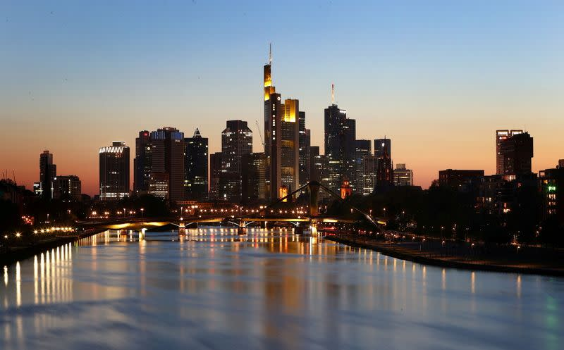FILE PHOTO: The skyline with the financial district is photographed during sunset in Frankfurt