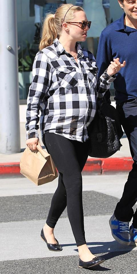 "<p>During an outing in Los Angeles, the actress showed off her growing bump in a black-and-white plaid shirt that she paired with black Seraphine maternity leggings ($45; <a rel=""nofollow"" href=""http://www.seraphine.com/us/overbump-bamboo-leggings.html"">seraphine.com</a>). Seyfried topped off her outfit with an embellished headband, sunglasses, black ballet flats, and a coordinating handbag.</p>"