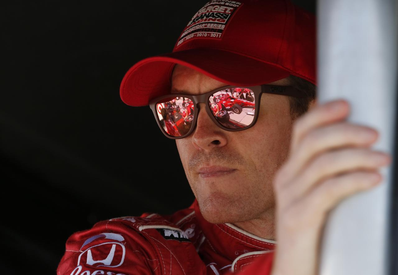 LONG POND PA - JULY 6: Scott Dixon of New Zealand driver of the #9 Target Chip Ganassi Racing Honda talks to a crew member during practice for the Pocono INDYCAR 400 at Pocono Raceway on July 6, 2013 in Long Pond Pennsylvania. (Photo by Jeff Zelevansky/Getty Images)
