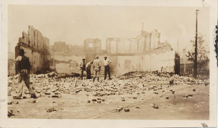 A portion of wall is all that remained of the Dreamland Theater in Tulsa's Greenwood District after angry white mobs burned down Black Wall Street in 1921.