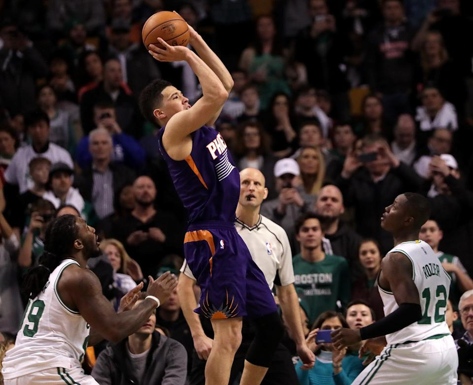 Phoenix Suns guard Devin Booker puts up a shot during his 70-point game against the Boston Celtics on March 24, 2017. (Barry Chin/The Boston Globe via Getty Images)