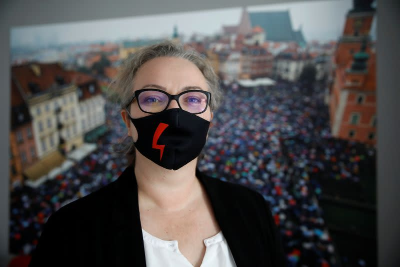 Marta Lampert, leader of movement Strajk Kobiet (Women's Strike), wears a face mask during an interview with Reuters, in Warsaw