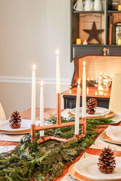 """<p>Piece together copper pipes into the <a href=""""https://www.countryliving.com/diy-crafts/a40726/copper-pipes-holiday-centerpiece/"""" rel=""""nofollow noopener"""" target=""""_blank"""" data-ylk=""""slk:prettiest Christmas centerpiece"""" class=""""link rapid-noclick-resp"""">prettiest Christmas centerpiece</a> ever. Just add candles, and you're done!</p><p><strong>Get the tutorial at <a href=""""https://www.prettyhandygirl.com/diy-copper-pipe-centerpiece/"""" rel=""""nofollow noopener"""" target=""""_blank"""" data-ylk=""""slk:Pretty Handy Girl"""" class=""""link rapid-noclick-resp"""">Pretty Handy Girl</a>.</strong></p><p><a href=""""https://www.amazon.com/s/ref=nb_sb_noss?url=search-alias%3Daps&field-keywords=taper+candles"""" rel=""""nofollow noopener"""" target=""""_blank"""" data-ylk=""""slk:SHOP TAPER CANDLES"""" class=""""link rapid-noclick-resp"""">SHOP TAPER CANDLES</a></p>"""