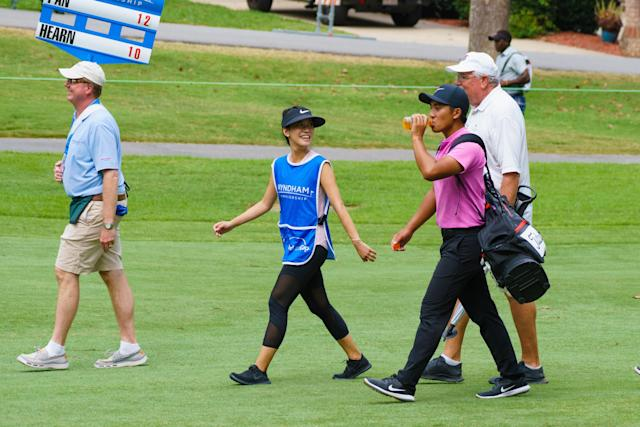 "<h1 class=""title"">GOLF: AUG 18 PGA - Wyndham Championship</h1> <div class=""caption""> GREENSBORO, NC - AUGUST 18: C.T. Pan carries his own clubs while giving his wife Michelle Lin a break as play is suspended during the third round of the Wyndham Championship on August 18, 2018, at Sedgefield Country Club in Greensboro, NC. (Photo by Jeremy McKnight/Icon Sportswire via Getty Images) </div> <cite class=""credit"">Icon Sportswire</cite>"