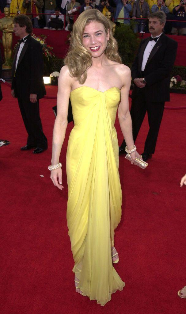 <p>The Bridget Jones' Diary' star wore a sorbet yellow 1950s Jean Dessè dress to the Oscars.</p>