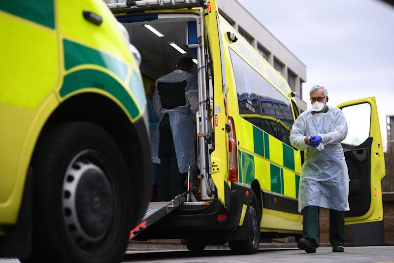 A paramedic wearing personal protective equipment (PPE) exits an ambulance outside St Thomas' Hospital in Westminster, London as the UK continues in lockdown to help curb the spread of the coronavirus.