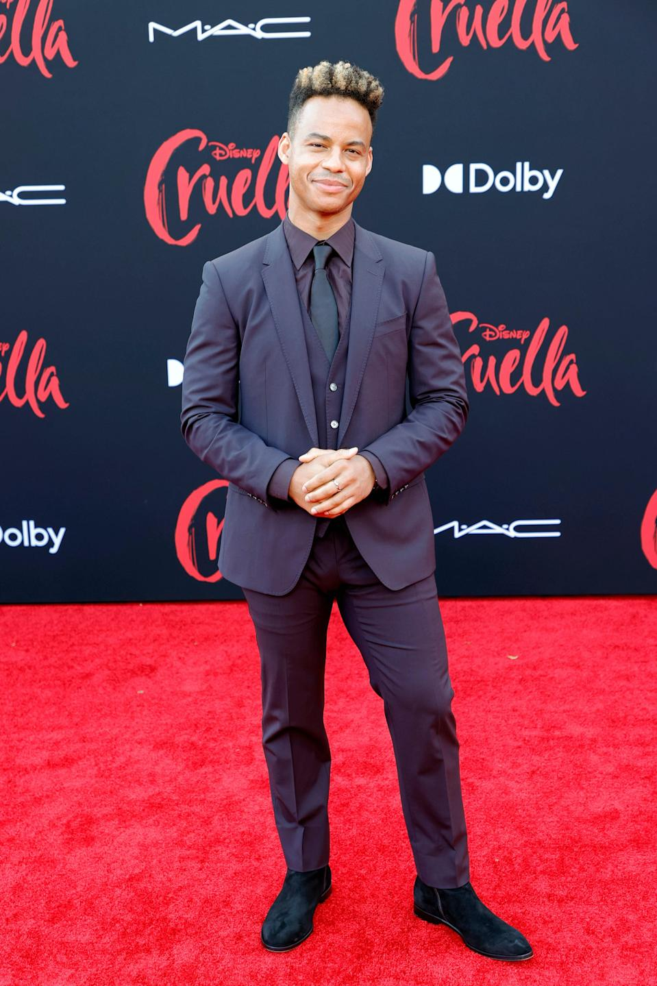 The fellow <em>HSM:TM:TS</em> actor had on a monochrome look consisting navy blue three-piece suit and a shirt and tie in similar tones.