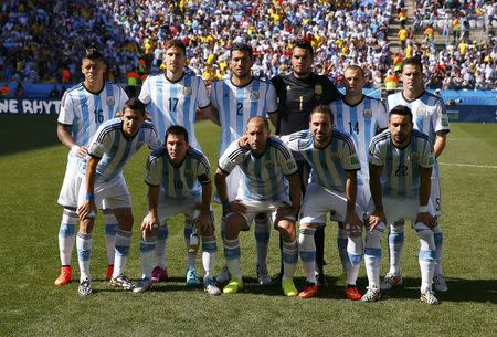 Argentina's national soccer players pose for a team photo before their 2014 World Cup round of 16 game against Switzerland at the Corinthians arena in Sao Paulo July 1, 2014. REUTERS/Paul Hanna