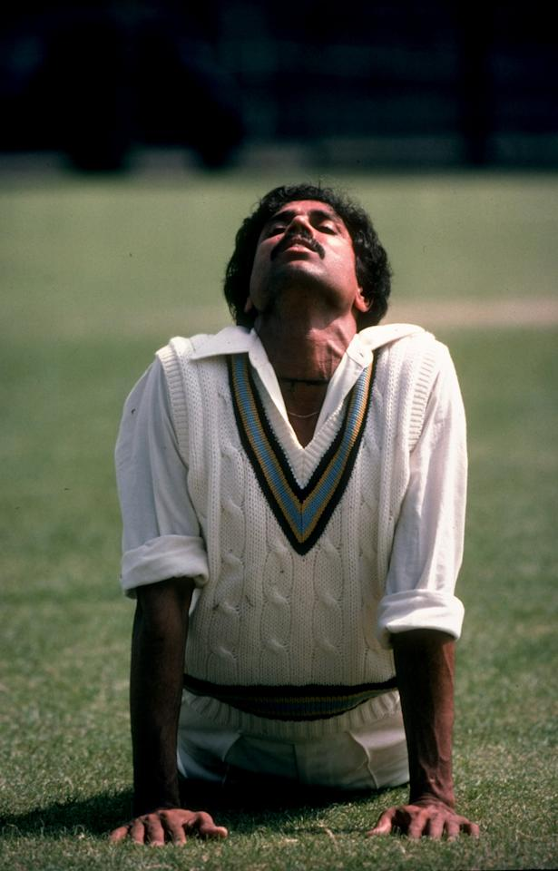 Dec 1984:  Kapil Dev of India stretches before a match. \ Mandatory Credit: Adrian  Murrell/Allsport