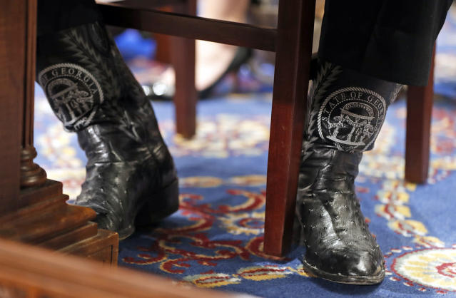 "<p>The boots of Agriculture Secretary, former Georgia Gov. Sonny Perdue are seen as he testifies on Capitol Hill in Washington, May 17, 2017, before a House Agriculture Committee hearing on ""State of the Rural Economy."" (Photo: Alex Brandon/AP) </p>"