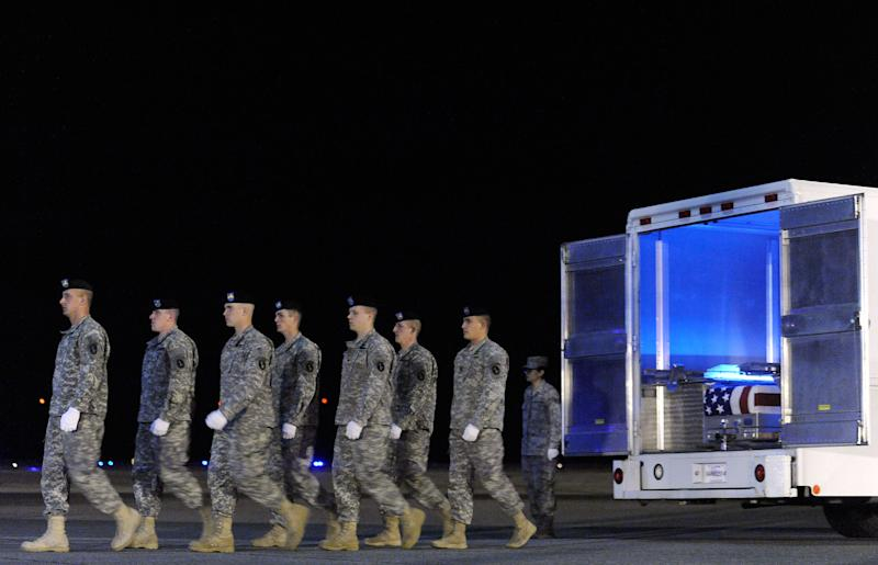An Army carry team marches away from a transfer case containing the remains of Staff Sgt. Dick A. Lee Jr. Sunday, April 29, 2012 at Dover Air Force Base, Del. According to the Department of Defense, Lee, 31, of Orange Park, Fla., died April 26, 2012 in Ghazni province, Afghanistan from injuries sustained when his vehicle encountered an improvised explosive device. (AP Photo/Steve Ruark)