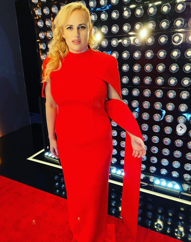 rebel wilson wearing red dress