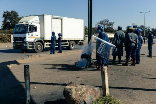 Police ask for travel documents at a road block in Mbare, a township in the suburbs of Harare