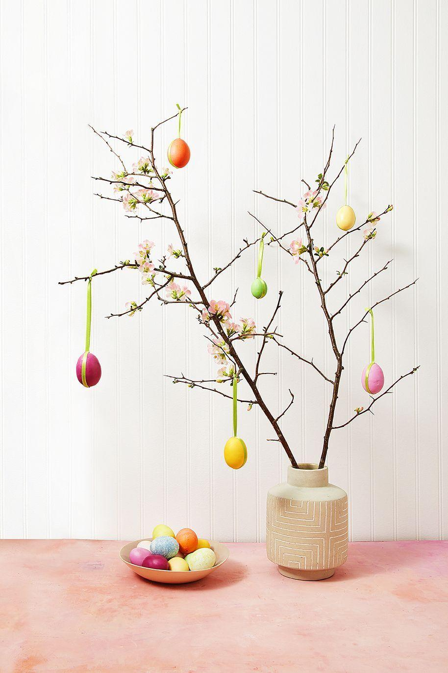 """<p>If you love sturdy branches like cherry blossoms, give them a new look for the holiday. Place a few in your favorite vase and dress them up with colorful egg ornaments that are decked out with pretty ribbon. <br><br><strong>RELATED</strong>: <a href=""""https://www.goodhousekeeping.com/holidays/easter-ideas/g26809936/diy-easter-tree-ideas/"""" rel=""""nofollow noopener"""" target=""""_blank"""" data-ylk=""""slk:How to Properly Decorate an Easter Tree"""" class=""""link rapid-noclick-resp"""">How to Properly Decorate an Easter Tree</a></p>"""