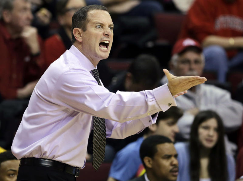 FILE - In this Feb. 9, 2013, file photo, Rutgers coach Mike Rice shouts from the sidelines during the first half of an NCAA college basketball game against Georgetown in Piscataway, N.J. The school's Board of Governors plans to discuss hiring an adviser to report on Rice's behavior and how the university handled it. (AP Photo/Mel Evans, File)