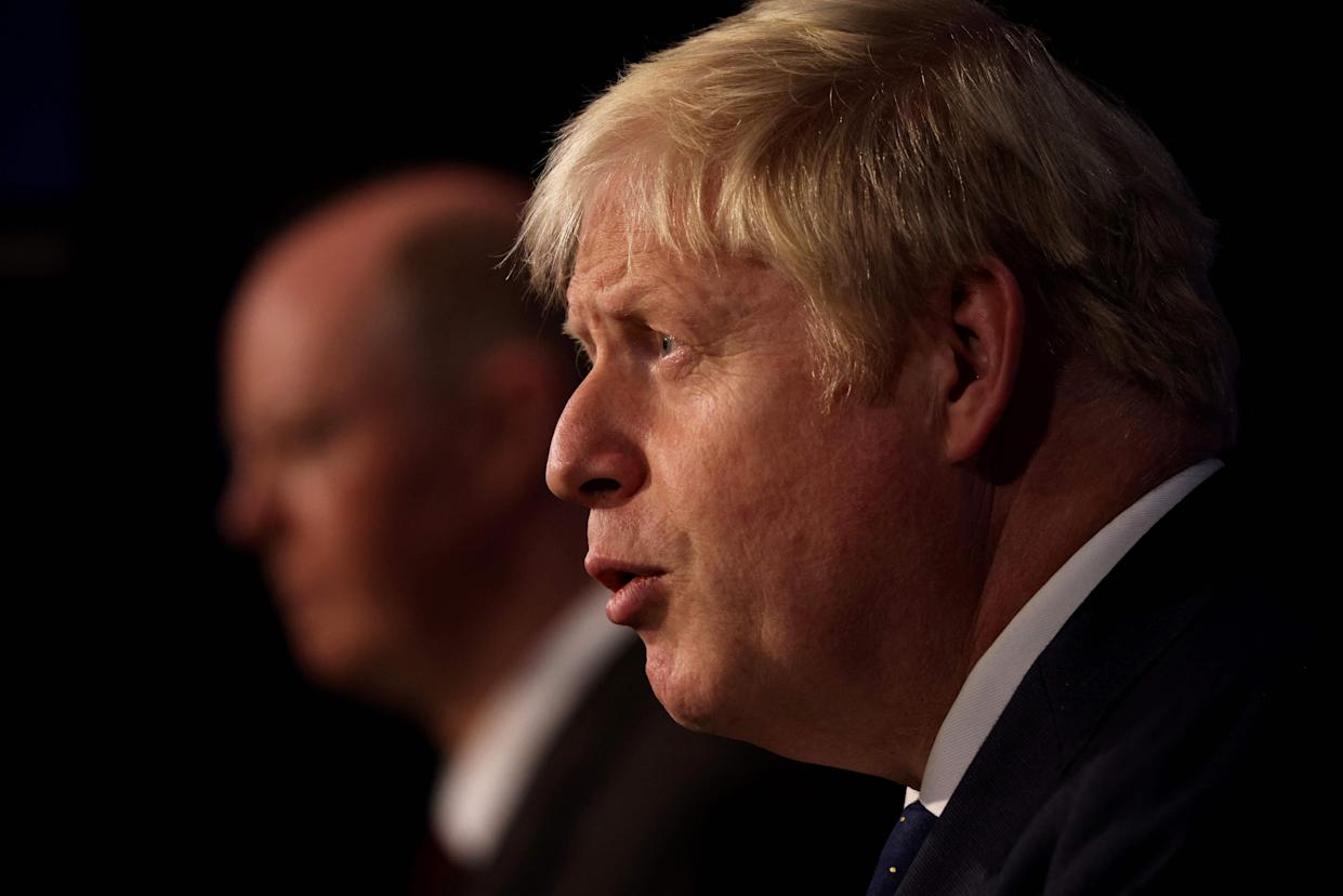 Britain's Prime Minister Boris Johnson (R) and Britain's Chief Medical Officer for England Chris Whitty attend a media briefing on the latest Covid-19 update, at Downing Street, central London on September 14, 2021. - Frontline health and social care workers, older people and the clinically vulnerable in Britain will start to receive a booster jab against Covid 19 from next week, the government said on Tuesday. (Photo by Dan Kitwood / POOL / AFP) (Photo by DAN KITWOOD/POOL/AFP via Getty Images)