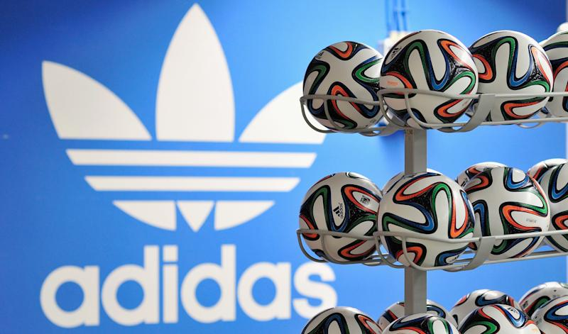 HERZOGENAURACH, GERMANY - DECEMBER 06: Brazuca match balls for the FIFA World Cup 2014 lie in a rack in front of the adidas logo on December 6, 2013 in Scheinfeld near Herzogenaurach, Germany. Brazuca is the Official Match Ball for the FIFA World Cup 2014 Brazil. (Photo by Lennart Preiss/Getty Images for adidas)