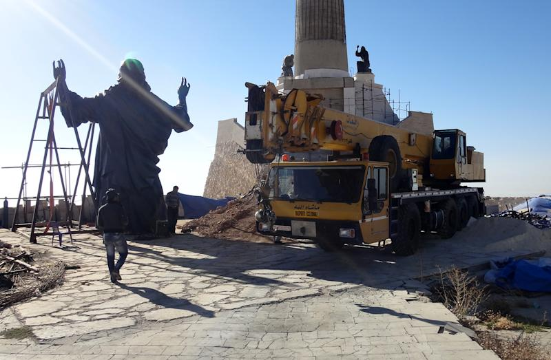 This Oct. 14, 2013 photo provided by the St. Paul's and St. George's Foundation shows workers preparing to install a statue of Jesus on Mount Sednaya, Syria. In the midst of a civil war rife with sectarianism, a 12.3-meter (40-foot) tall, bronze statue of Jesus has gone up on a Syrian mountain, apparently under cover of a truce among three factions - Syrian forces, rebels and gunmen in the Christian town of Sednaya. (AP Photo/Samir El-Gadban, St. Paul's and St. George's Foundation)