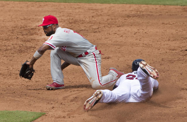 Atlanta Braves right fielder Jason Heyward (22) steals second base as Philadelphia Phillies shortstop Jimmy Rollins (11) handles the throw in the third inning of a baseball game Monday, Sept. 1, 2014, in Atlanta. (AP Photo/John Bazemore)
