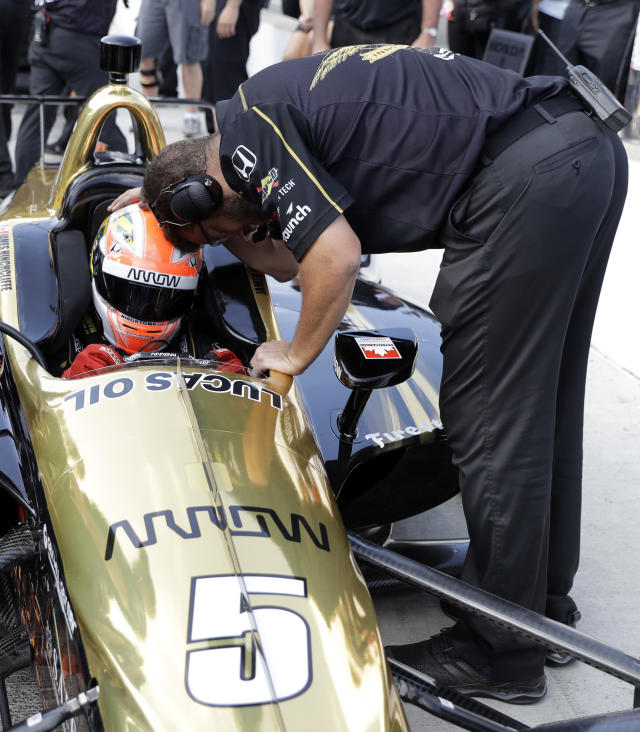 James Hinchcliffe, of Canada, is consoled by a crew member after not qualifying for the IndyCar Indianapolis 500 auto race at Indianapolis Motor Speedway in Indianapolis Saturday, May 19, 2018. (AP Photo/Darron Cummings)