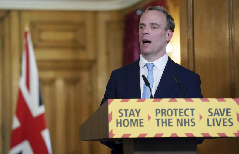 In this photo provided by 10 Downing Street, Britain's Foreign Secretary Dominic Raab delivers a speech, during a coronavirus briefing in Downing Street, London, Monday April 6, 2020. (Pippa Fowles/10 Downing Street via AP)